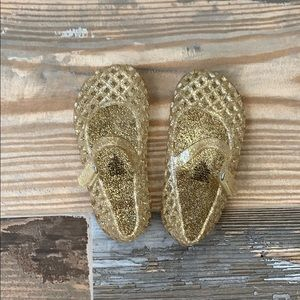 Gold glitter jelly shoes